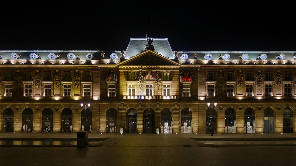 Illuminated facade of the Aubette