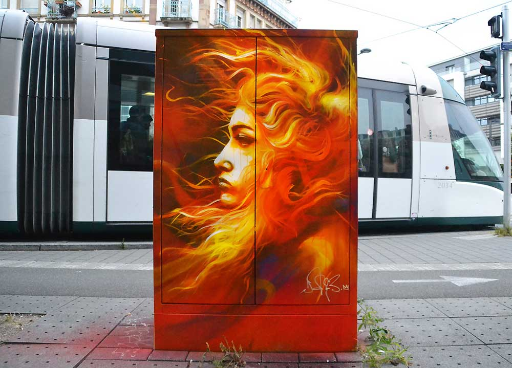 A woman in fire on an electrical cabinet